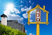 pic of house rent  - Yellow wooden meter ruler in the shape of house and label with text for rent - JPG