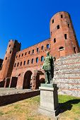 image of torino  - Roman statue of Julius Caesar and ancient ruins of Palatine Towers in Torino Piemonte Italy - JPG