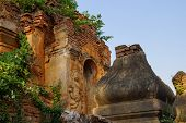 picture of guardian  - Guardian spirit on the walls of an ancient stupa at In Dein Inle Lake Myanmar  - JPG