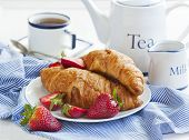 stock photo of croissant  - Fresh Croissants And Cup Of Tea for breakfast  - JPG