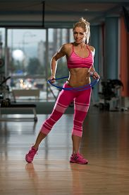 picture of hulahoop  - Middle Age Womane Playing Around With Hula Hoop Rings - JPG