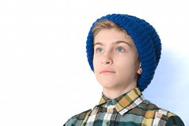 picture of pre-adolescents  - Portrait of a Tween Boy with a blue hat - JPG