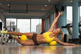 pic of pilates  - Aerobics Pilates Woman With Yoga Balls On Fitness Class  - JPG