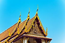 stock photo of gable-roof  - roof of monastery Wat Na Phramane in Ajutthaya with famous gold buddha and roof carvings - JPG