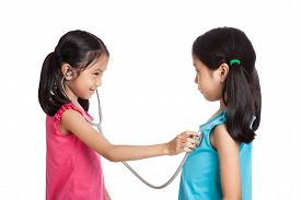 foto of identical twin girls  - Happy Asian twins girls with stethoscope isolated on white background  - JPG