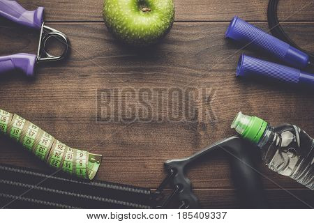 poster of different fitness and street workout objects. fitness objects on the table. fitness and street workout concept. fitness objects on brown wooden table with copy space