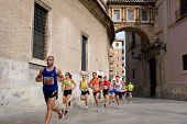 VALENCIA, SPAIN - JULY 4: Runners compete in the I Volta a Peu de les Falles de Valencia 6 km run on