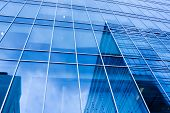 stock photo of business-office  - turquoise abstract wall of modern business office skyscraper - JPG