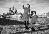 Mother And Child Travellers In Paris Pointing At Something poster
