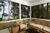 image of beach-house  - screen porch with beach view and wicker furniture - JPG