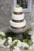 wedding cake and bouquets on table