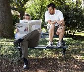 picture of pissed off  - dirty person reading newspaper over businessman - JPG