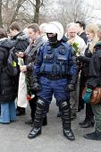 RIGA, LATVIA - MARCH 16: Local police guards the crowd at the Freedom Monument during Commemoration