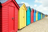 Beach huts or colorful bathing boxes on the beach poster