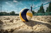 Beach Volleyball. Game ball under sunlight and blue sky. poster