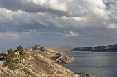 stock photo of horsetooth reservoir  - Horsetooth Reservoir with Centennial highway near Fort Collins Colorado high wind conditions and heavy clouds in early spring - JPG