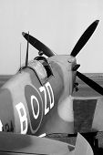 picture of spitfire  - Cockpit of a mark IX British Spitfire parked beside a grass runway - JPG