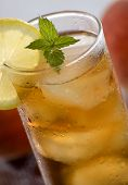 stock photo of iced-tea  - cold fresh ice tea with lemon close up shoot - JPG