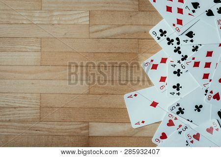 Cards Lying On Rustic Wood