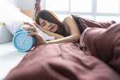 Young Woman Yawn Awakening Tired Holding Alarm Clock. Wake Up Early In Morning. Girl Stop Snooze Ala poster