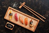 Assorted Sushi Set On A Dark Rustic Background. Japanese Food Sushi On A Wooden Plate, Soy Sauce, Ch poster