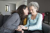 Positive Elderly Woman And Her Daughter Having Fun And Holding Hands. Mother And Daughter Sitting On poster