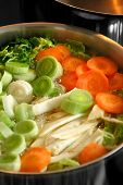 stock photo of vegetable soup  - A boiling pot of vegetable soup on top of the stove - JPG