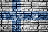 National Flag Of Finland On A Brick Background. Concept Image For Finland: Language , People And Cul poster