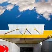 This Simple Building Has A Remarkable Architecture And Color Scheme. It Uses The Primary Colors Yell poster