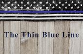 The Thin Blue Line Message, Usa Thin Blue Line Flag On A Weathered Wood Background With Text The Thi poster