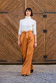 Fashion And Style Concept. Girl With Makeup Posing In Fashionable Clothes. Fashionable Outfit Slim T poster