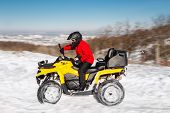 Photo Of Young Extremal Driver In Red Warm Winter Clothes And Black Helmet Drive His Atv 4wd Quad Bi poster