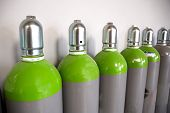 Seamless Steel Industrial Gas Cylinders. Pressurized Cylinder. Industrial Stainless Steel Bottles In poster