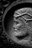 Detail of stone carving of Christ with crown of thorns for Christian Christianity poster