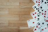 Cards Lying On Rustic Wood Table, Playing Cards. Copy Space. poster