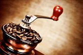 foto of wooden box from coffee mill  - Contrast image of vintage coffee mill or grinder with coffee beans  - JPG