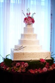 stock photo of marriage ceremony  - An image of a beautiful cake at a wedding reception - JPG
