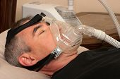 foto of respiratory disease  - Man with sleeping apnea and CPAP machine - JPG