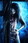 Bloodthirsty zombi standing at the night cemetery in the mist and moonlight. poster