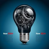 stock photo of machinery  - Light bulb with gears inside - JPG