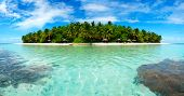 stock photo of indian blue  - Beautiful Maldivian atoll with white beach seen from the sea - JPG