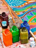foto of batik  - paintbrushes and bottles with pigments for cold batik - JPG