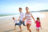 image of children beach  - Happy family running on the beach - JPG