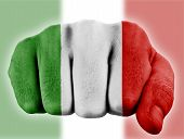 image of italian flag  - fist with digitally painted flag of italy - JPG