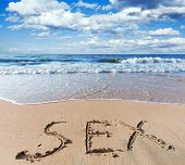 sea beach with sand word sex