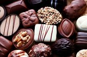picture of gourmet food  - various chocolates as a background  - JPG