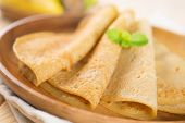 stock photo of crepes  - Close up Asian style breakfast homemade banana pancakes or crepe on dining table - JPG