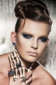 picture of queer  - Surrealistic fashion portrait of young beautiful woman with dramatic makeup - JPG