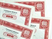 picture of debenture  - Red common stock certificates - JPG