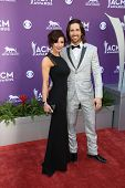 Jake Owen and Lacey Buchanan Owen at the 48th Annual Academy Of Country Music Awards Arrivals, MGM G